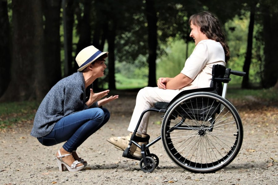 woman-on-black-folding-wheelchair